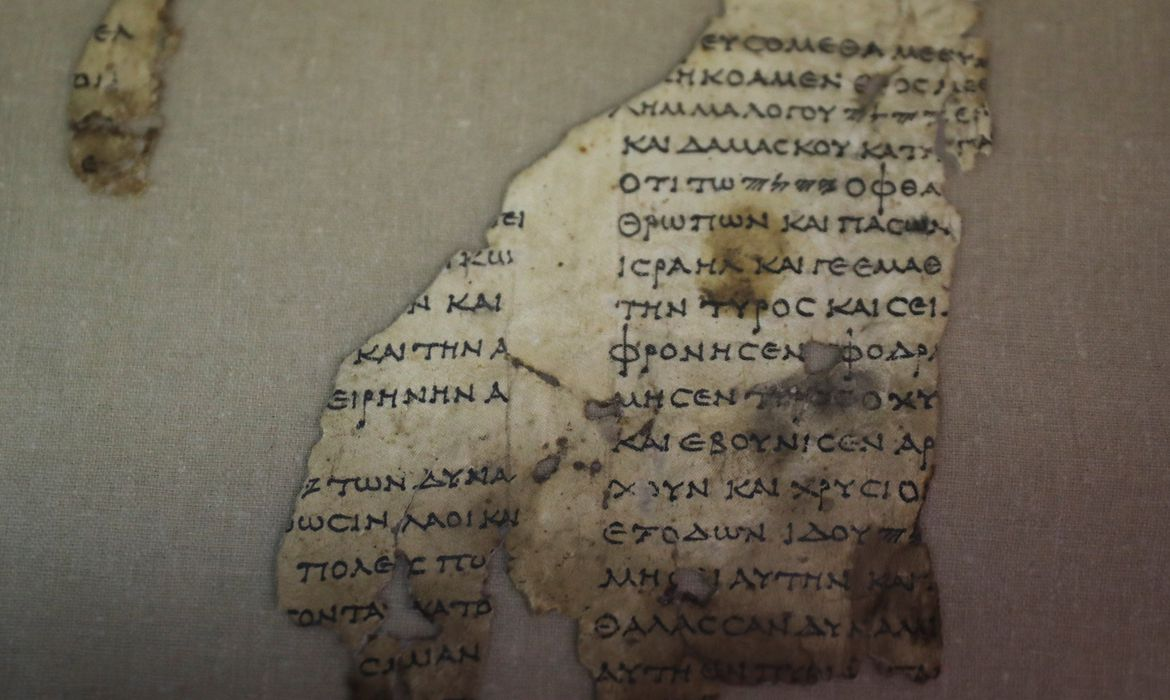 A recently-discovered scroll fragment of an ancient biblical text is seen at Israel Antiquities Authority laboratories in Jerusalem