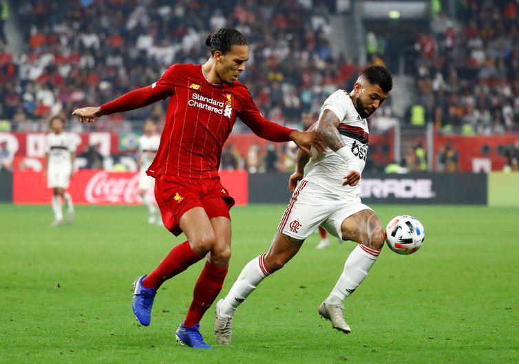 Soccer Football - Club World Cup - Final - Liverpool v Flamengo - Khalifa International Stadium, Doha, Qatar - December 21, 2019  Liverpool's Virgil van Dijk in action with Flamengo's Gabriel Barbosa   REUTERS/Corinna Kern