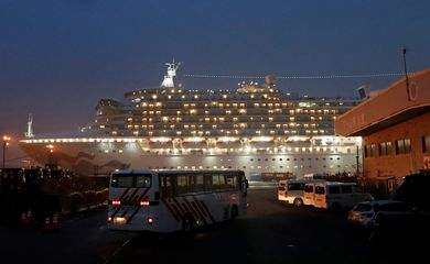 A bus arrives at the cruise ship Diamond Princess at Daikoku Pier Cruise Terminal in Yokohama