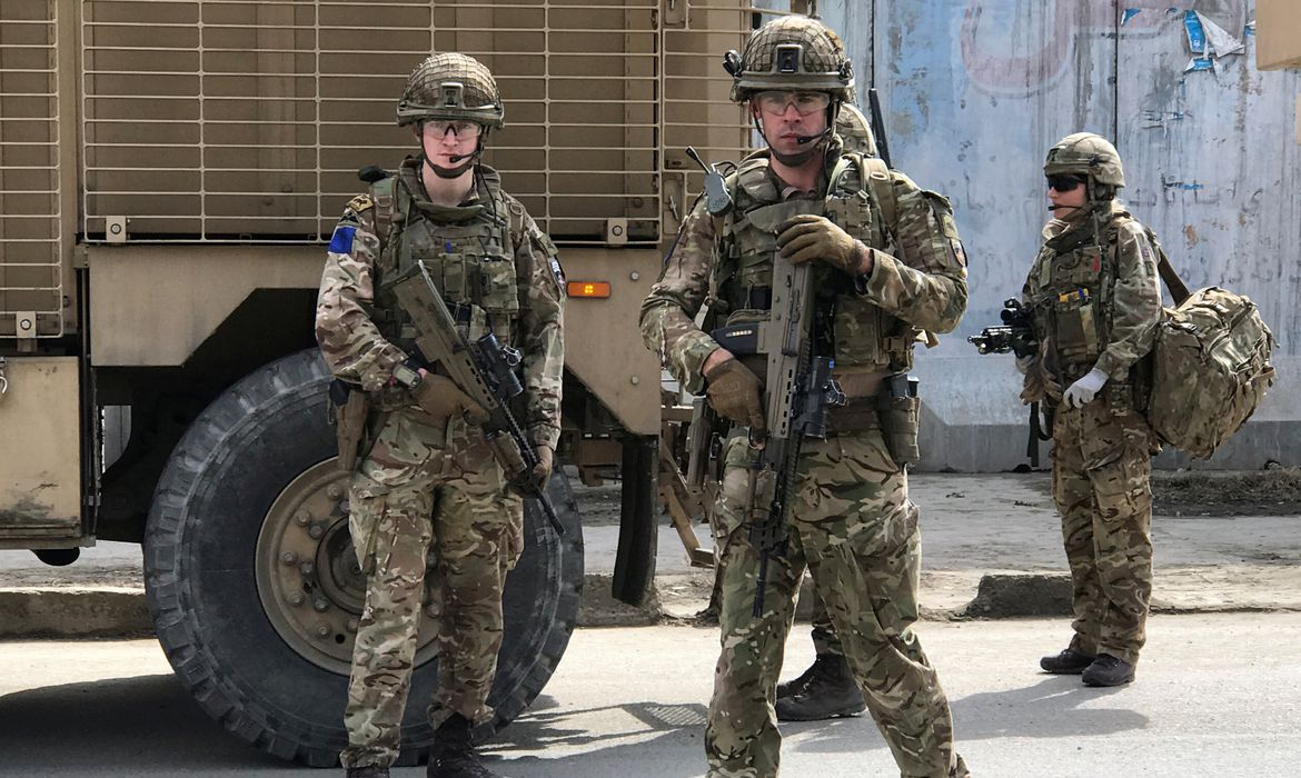 British soldiers with NATO-led Resolute Support Mission arrive at the site of an attack in Kabul
