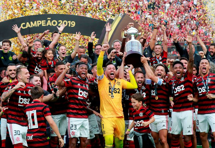 Soccer Football - Copa Libertadores - Final - Flamengo v River Plate - Monumental Stadium, Lima, Peru - November 23, 2019  Flamengo's Diego Alves, Everton Ribeiro and Diego lift the trophy with team mates as they celebrate after winning the