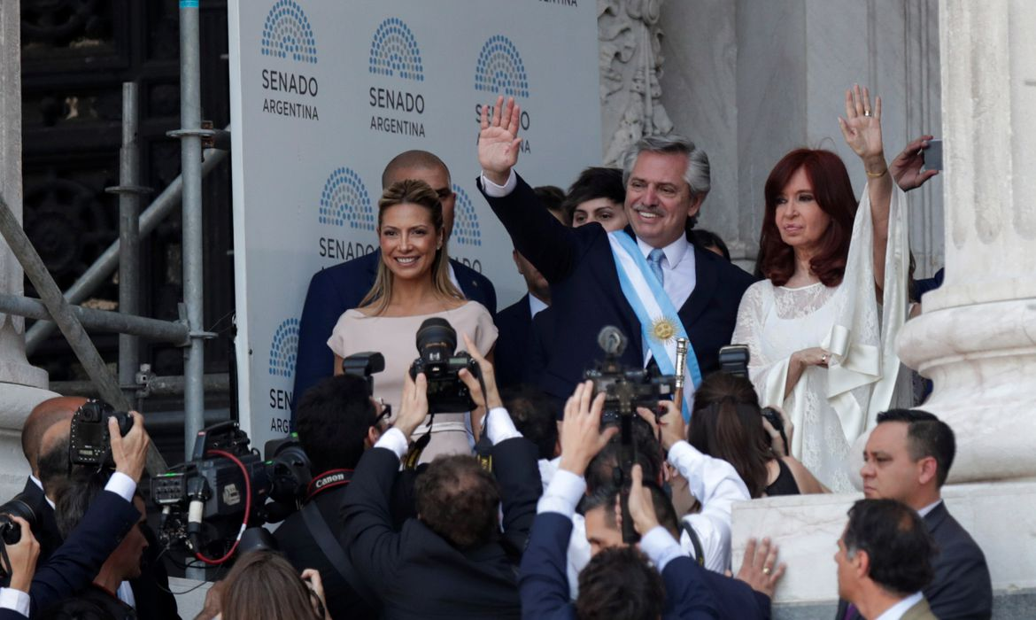 Argentina's President Alberto Fernandez waves next to his partner Fabiola Yanez and Vice President Cristina Fernandez de Kirchner after the swearing-in ceremony, in Buenos Aires, Argentina December 10, 2019. REUTERS/Ueslei Marcelino