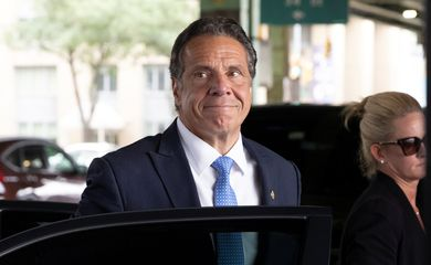New York Governor Andrew Cuomo arrives to depart in his helicopter after announcing his resignation in Manhattan, New York City