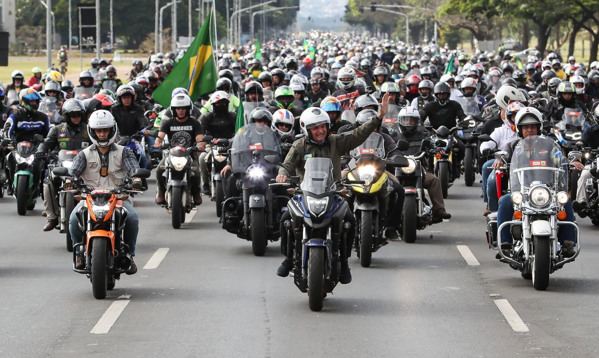 Brazil's President Jair Bolsonaro and his supporters ride motorcycles to celebrate the National Mother's Day