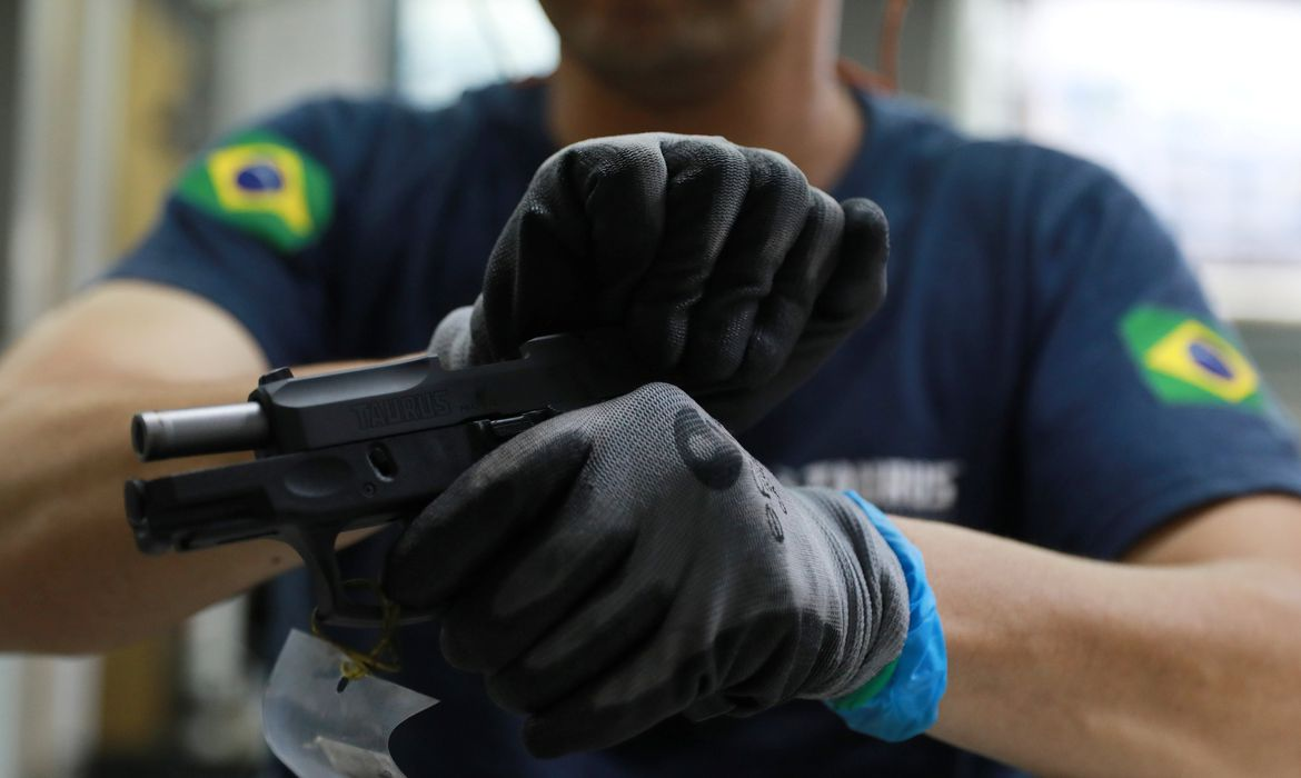 An employee from gun manufacturer Taurus Armas SA works at the company's assembly line in Sao Leopoldo, Brazil January 15, 2019. REUTERS/Diego Vara